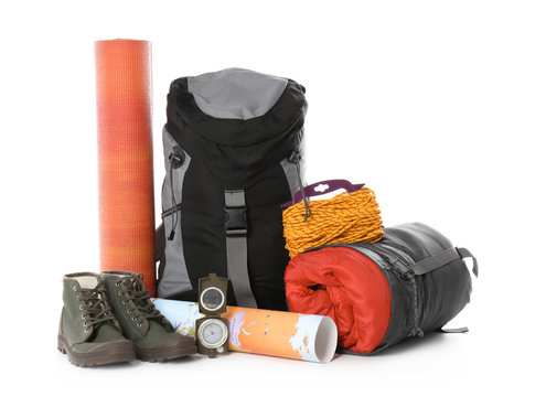 Set of camping equipment with sleeping bag on white background