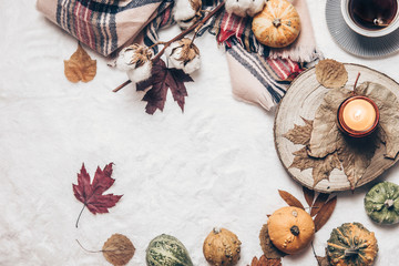Autumn composition. Hot tea, autumn leaves, on cozy background. Flat lay, top view, copy space.