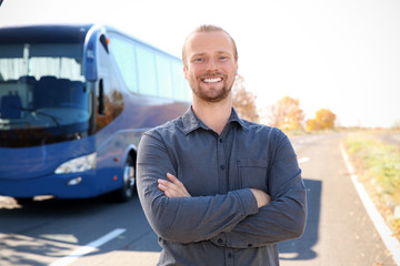 Professional driver standing near bus. Passenger transportation Fototapete