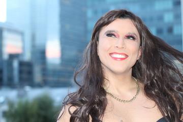 Stunning transgender woman smiling outdoors