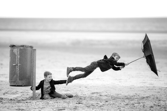 children fly away through the wind in the storm