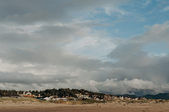 Seaside Town with Cloudy Skies