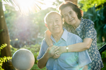 Happy Senior Asian Couple in a Park