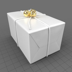 Wrapped christmas gift with golden bells