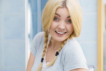 Lovely blonde woman in braids