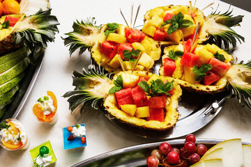 Modern desserts, cupcakes, sweets with fruits. Delicious candy bar.
