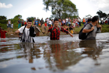 Central American migrants cross the Suchiate River, the natural border between Guatemala and Mexico, to reach the U.S., as seen from Ciudad Hidalgo