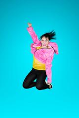 Joyful modern style dancer jumping in studio