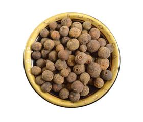 Fototapeta Allspice also called pimenta or Jamaica pimenta, or myrtle pepper. Isolated obraz