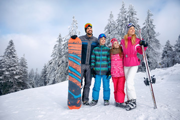 .Happy family with two children on winter vacation in mountain.
