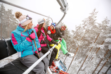Female and male skiers in ski lift