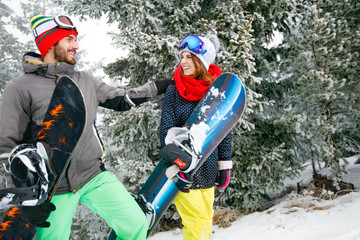 Snowboarders couple in mountain on skiing