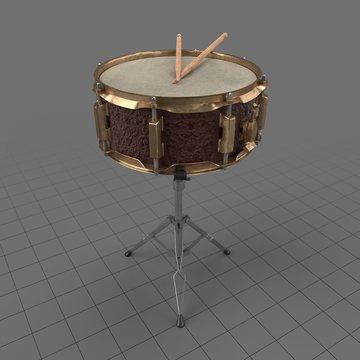 Antique snare drum with drumsticks