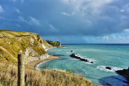 Dramatic sky over scenic jurassic  coastline of Dorset,Uk.