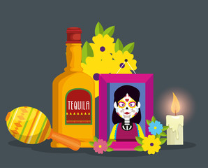 picture with tequila and candle to celebrate day of the dead