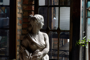 Sculpture in half-naked woman's plaster