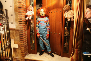 "A boy dressed up as the character Chucky from the movie ""Child's Play"" poses for a photo as he takes part in the ""Noche del Terror"" (Horror night) during Halloween celebrations in the neighborhood of Churriana, near Malaga"
