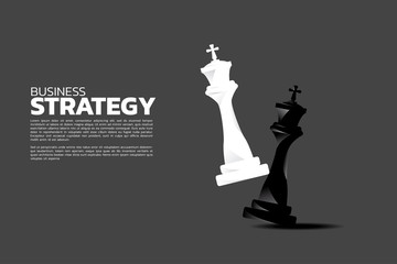 white king take a checkmate on chess board game. concept of business strategy and win competition.