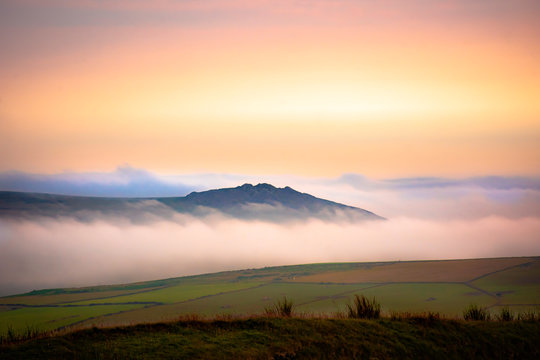 Scenic landscape of Pembrokeshire coast, Uk.Sunrise over misty fields.