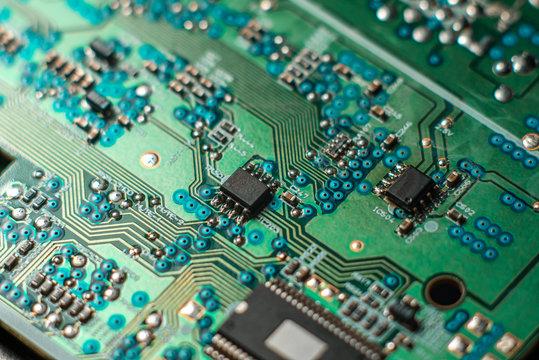 Minsk, Belarus, 2018. Computer chip on green motherboard closeup macro. Computer technology concept