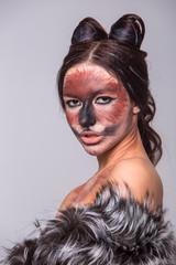 Portrait of a girl makeup and makeup cats