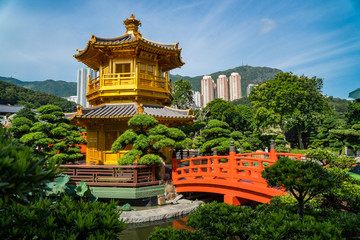 Beautiful gold pagoda in a busy urban city. Hong Kong