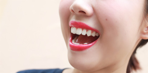 Woman mouth smile with great teeth on background.