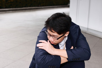 Anxiety stressed young Asian business man suffering from severe trouble