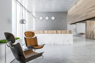 Marble reception desk in gray office