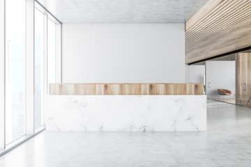 Marble reception desk in white office