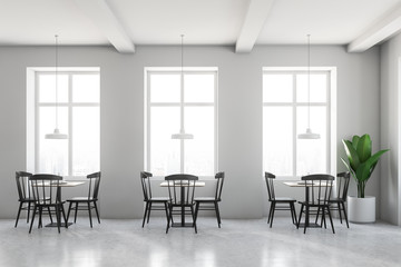 White cafe interior, black chairs