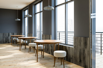 Gray cafe interior, round tables