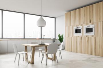 Loft kitchen corner with white chairs