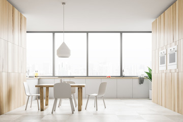 Panoramic white kitchen with wooden table