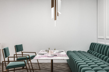 White restaurant with green sofa and chairs