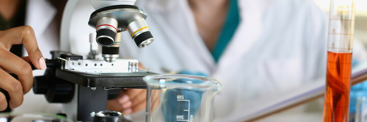Two scientists of a student chemist are conducting