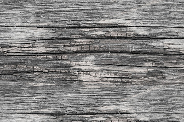 Texture of very old decayed wooden boards with natural pattern, abstract grunge retro background,