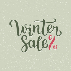 Winter sale hand written inscription with isolated on blurred abstract background with snowflakes.  illustration. Lettering. Postcard for winter season advertising.