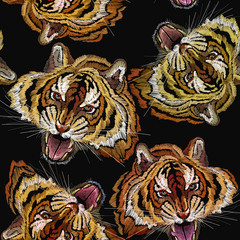 Embroidery tiger head seamless pattern. Clothes, textile design template