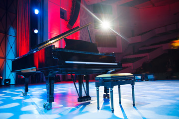 the piano on stage in the spotlight. Wall mural