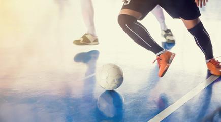 Indoor soccer sports hall. Football futsal player