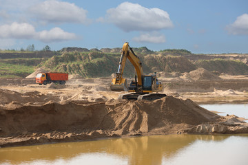 Excavator loader machine during earthmoving works