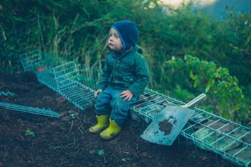 Little toddler sitting on a gabian