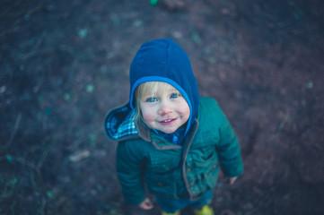 Little toddler standing outside in the garden