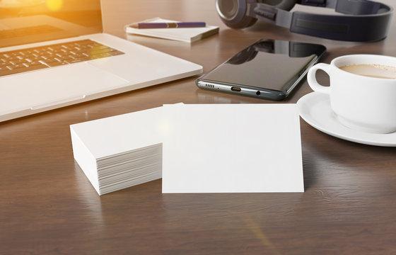 Business cards on wooden desk mockup 3d rendering