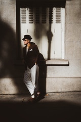 Portrait of a retro looking man walking in the streets of Paris, Montmartre