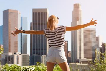 Happy woman enjoying the view Los Angeles downtown, California, USA
