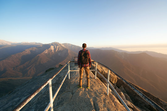 Travel in Sequoia National Park, man Hiker with backpack enjoying view Moro Rock, California, USA