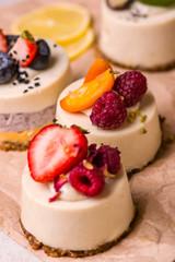 Cupcake with strawberries, raspberries, blueberries, close-up.