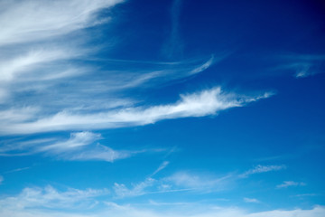 amazing white clouds of unusual shape on blue sky background